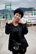 Portrait of a woman at Yeosu-si harbour. Yeosu-si, Jeollanam-do. South Korea, Republic of Korea, KOR, 24.05.2009.