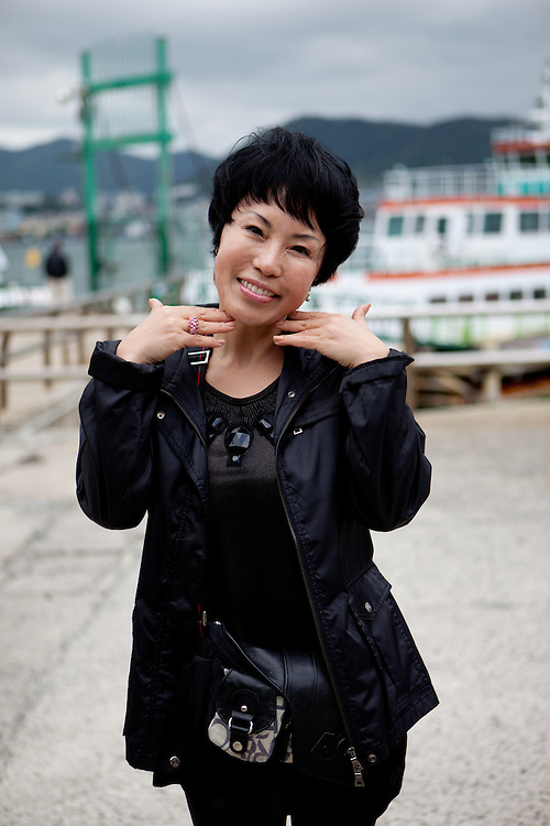 Portrait of a woman at Yeosu-si harbour. Yeosu-si, Jeollanam-do. South Korea, Republic of Korea, KOR, 24.05.2009.