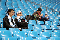 """Manchester City fans in the stands during the Premier League match at the Etihad Stadium, Manchester. PRESS ASSOCIATION Photo. Picture date: Saturday December 16, 2017. See PA story SOCCER Man City. Photo credit should read: Martin Rickett/PA Wire. RESTRICTIONS: EDITORIAL USE ONLY No use with unauthorised audio, video, data, fixture lists, club/league logos or """"live"""" services. Online in-match use limited to 75 images, no video emulation. No use in betting, games or single club/league/player publications."""
