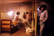 Cowboys in the bunkhouse at the Spanish Ranch in  Nevada.