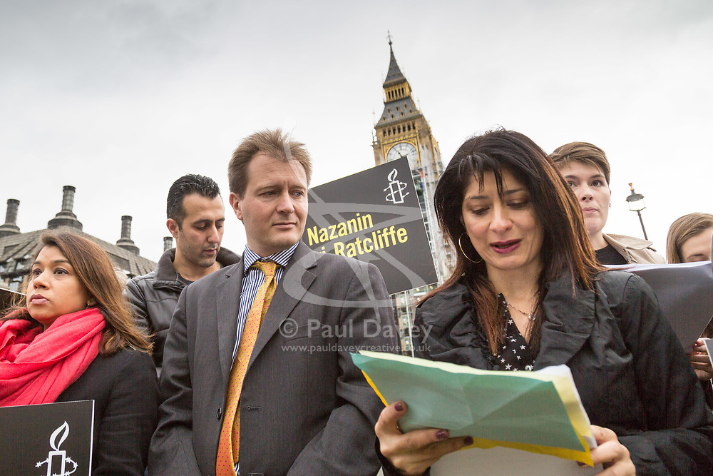 London, October 11 2017. Family members, friends and supporters from Amnesty International attend a protest and vigil in Parliament Square for Nazanin Zaghari-Ratcliffe and Kamal Foroughi, both dual British and Iranian citizens imprisoned in Iran. Zaghari-Ratcliffe was detained in Tehran last year along with her baby daughter Gabriella following a holiday and has been imprisoned on sedition charges. She was told over the weekend that additional charges are being brought against her, carrying an additional 16 years of imprisonment. Foroughi should have been released from prison in January 2014 after serving a third of his sentence. PICTURED: Supporters  read out statements of friendship, with Richard, husband of Nazanin Zaghari-Ratcliffe, centre. © Paul Davey