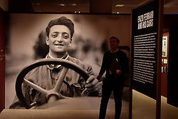 """© Licensed to London News Pictures. 14/11/2017. London, UK.  A large photograph of Enzo Ferrari greets visitors to the exhibition.  Preview of """"Ferrari: Under the Skin"""", an exhibition at the Design Museum to mark the 70th anniversary of Ferrari.  Over GBP140m worth of Ferraris are on display from private collections including Michael Schumacher's 2000 F1 winning car.  The exhibition runs 15 November to 15 April 2018.  Photo credit: Stephen Chung/LNP"""