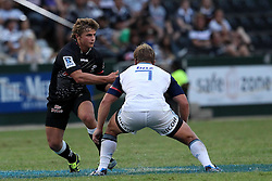 Patrick Lambie of The Sharks offloads before the tackle during the Super15 match between The Mr Price Sharks and The Blues held at Mr Price Kings Park Stadium in Durban on the 26th February 2011..Photo By:  Ron Gaunt/SPORTZPICS
