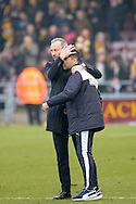Cambridge United Manager Shaun Derry celebrates with his assistant on the pitch  during the Sky Bet League 2 match between Northampton Town and Cambridge United at Sixfields Stadium, Northampton, England on 12 March 2016. Photo by Dennis Goodwin.