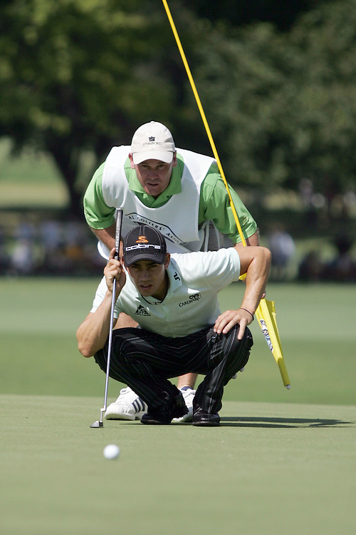 09 August 2007: Camillo Villegas and caddie Gary Matthews analyze the 3rd green during the first round of the 89th PGA Championship at Southern Hills Country Club in Tulsa, OK.