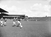 Chasing the ball during the All Ireland Minor Gaelic Football Final Cork v. Mayo in Croke Park on the 24th September 1961.
