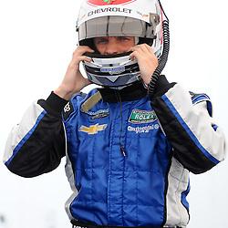 June 30, 2012 - Spirit of Daytona driver Antonio Garcia pulls on his helmet before qualifying for The Grand-Am Rolex Sports Car Series Sahlen's Six Hours of the Glen.