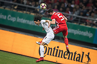 """Edinson Cavani, left, of Uruguay national football team heads the ball to make a pass against James Chester of Wales national football team in their final match during the 2018 Gree China Cup International Football Championship in Nanning city, south China's Guangxi Zhuang Autonomous Region, 26 March 2018.<br /> <br /> Edinson Cavani's goal in the second half helped Uruguay beat Wales to claim the title of the second edition of China Cup International Football Championship here on Monday (26 March 2018). """"It was a tough match. I'm very satisfied with the result and I think that we can even get better if we didn't suffer from jet lag or injuries. I think the result was very satisfactory,"""" said Uruguay coach Oscar Tabarez. Wales were buoyed by a 6-0 victory over China while Uruguay were fresh from a 2-0 win over the Czech Republic. Uruguay almost took a dream start just 3 minutes into the game as Luis Suarez's shot on Nahitan Nandez cross smacked the upright. Uruguay were dealt a blow on 8 minutes when Jose Gimenez was injured in a challenge and was replaced by Sebastian Coates. Inter Milan's midfielder Matias Vecino of Uruguay also fired at the edge of box from a looped pass but only saw his attempt whistle past the post. Suarez squandered a golden opportunity on 32 minutes when Ashley Williams's wayward backpass sent him clear, but the Barca hitman rattled the woodwork again with goalkeeper Wayne Hennessey well beaten."""