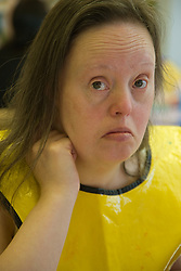Portrait of young woman with downs syndrome looking serious,
