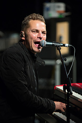 """@Licensed to London News Pictures 10/09/17. Lead singer of Toploader, Joseph Washbourn, performs  their most recognised hit """"Dancing in the Moonlight"""" at the Hop & Harvest Festival in Maidstone in Kent.  Photo credit: Manu Palomeque/LNP"""