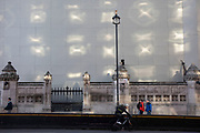 Reflections on a white hoarding from opposite windows against the Palace of Westminster, which is under refurbishment in London, England, United Kingdom.
