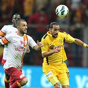 Galatasaray's Emre Colak (L) and Eskisehirspor's Erkan Zengin (R) during their Turkish Super League soccer match Galatasaray between Eskisehirspor at the TT Arena at Seyrantepe in Istanbul Turkey on Saturday, 06 October 2012. Photo by TURKPIX