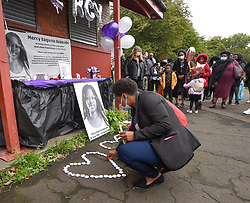 Pictured: Friends and supporters lit candles at the vigil.<br /> <br /> Friends and supporters held a vigil in Govan in memory of tragic asylum seeker Mercy Baguma, who was found dead next to her baby son on 22nd August at a flat in the city.<br /> <br /> © Dave Johnston / EEm
