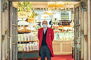 Mcc0095596 . Daily Telegraph<br /> <br /> DT News<br /> <br /> Doormen at the prestigious Fortnum and Mason in Piccadilly wearing face masks due to Covid, the store has been open for some time  .<br /> <br /> Non essential retail outlets are allowed to open from Monday 15th .<br /> <br /> London 11 June 2020