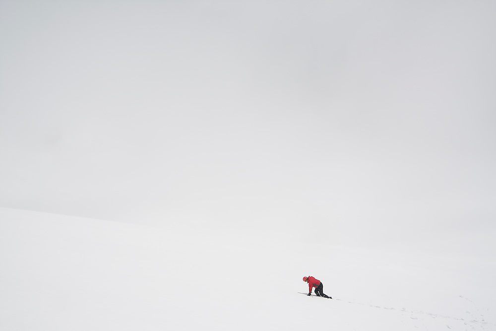 A climber traverses barren snow at Paradise in Mount Rainier National Park, Washington.