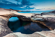 Soft shaped white rocks by the sea