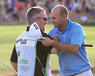 """22 JAN 15  Scott Gneiss with Bill Haas on the 18th green at the conclusion of Sunday""""s Final Round at The Humana Challenge at PGA West, in LaQuinta, California.(photo credit : kenneth e. dennis/kendennisphoto.com)"""
