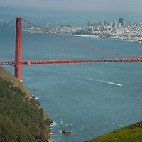 The Golden Gate Bridge spans from the Marin Headlands in the foreground to San Francisco.