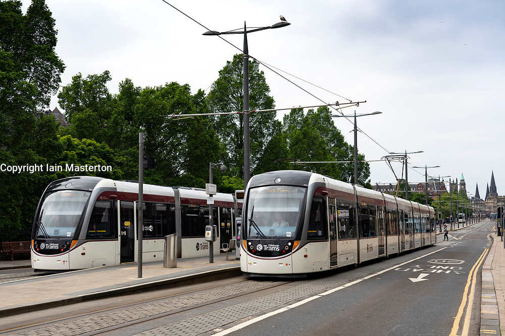 Edinburgh trams at stop on Princes Street, Scotland, UK