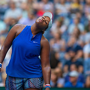 2019 US Open Tennis Tournament- Day Four.  Taylor Townsend of the United States reacts during her match against Simona Halep of Romania in the Women's Singles Round Two match on Arthur Ashe Stadium at the 2019 US Open Tennis Tournament at the USTA Billie Jean King National Tennis Center on August 29th, 2019 in Flushing, Queens, New York City.  (Photo by Tim Clayton/Corbis via Getty Images)
