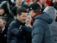 Diego Simeone manager of Atletico Madrid and Jurgen Klopp manager of Liverpool touch elbows instead of shaking handsduring the UEFA Champions League match at Anfield, Liverpool. Picture date: 11th March 2020. Picture credit should read: Darren Staples/Sportimage