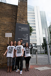 "© Licensed to London News Pictures. 13/10/2012. London, UK. Campaigners (left to right women: Lucy Anne Holmes, Pavan Amara, Sarah Anderson and Joanna Cheetham) outside the News International offices in Wapping after delivering a letter to Dominic Mohan, editor of The Sun newspaper demanding an end to topless models on Page 3. An online petition started by Lucy Holmes is campaigning to ""Take the bare boobs out of The Sun"". Photo credit : Vickie Flores/LNP"
