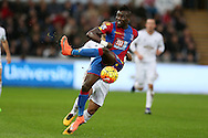 Pape Souare of Crystal Palace holds off Wayne Routledge of Swansea city. Barclays Premier league match, Swansea city v Crystal Palace at the Liberty Stadium in Swansea, South Wales on Saturday 6th February 2016.<br /> pic by Andrew Orchard, Andrew Orchard sports photography.