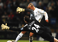Photo: Paul Greenwood.<br />Bolton Wanderers v Arsenal. The FA Cup. 14/02/2007. Arsenal goalkeeper Manuel Almunia saves at the feet of Boltons Stelios
