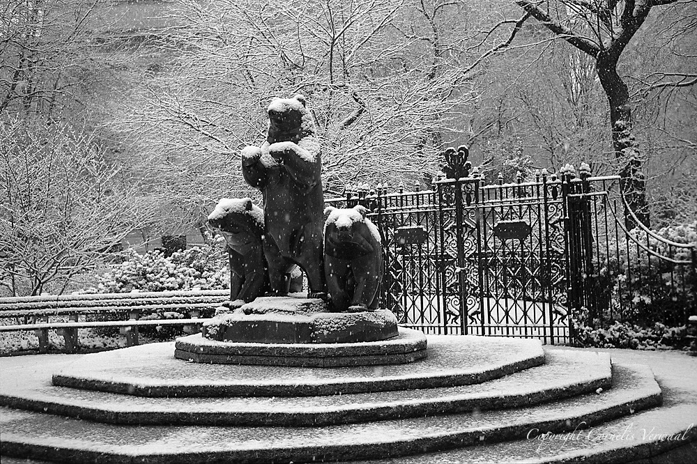 This bronze sculpture by Paul Manship depicts a group of three bears on a circular stepped pedestal. Located at the Pat Hoffman Friedman Playground at Fifth Avenue and 79th Street, the piece was a gift from Samuel N. Friedman in memory of his wife, Pat. The piece was cast in 1960 and unveiled on October 11, 1990 at the playground dedication.