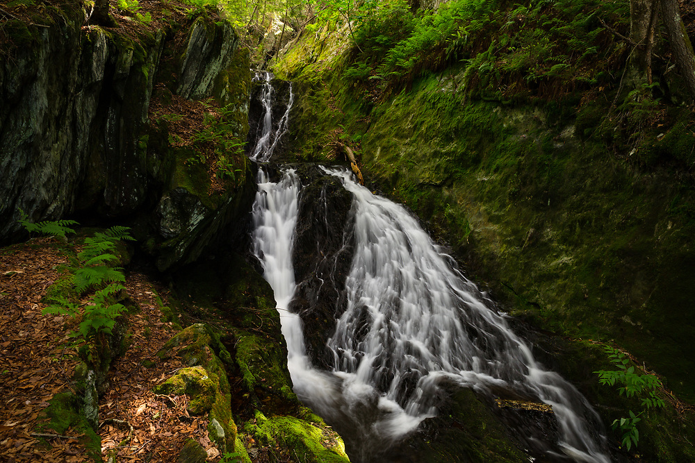 Water sliding through the rugged and remote terrain at Parker Brook Falls.