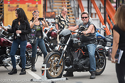 Checking out the new 2017 bikes at the Harley-Davidson display at Daytona Speedway during Daytona Bike Week. Daytona Beach, FL. USA. Monday March 13, 2017. Photography ©2017 Michael Lichter.