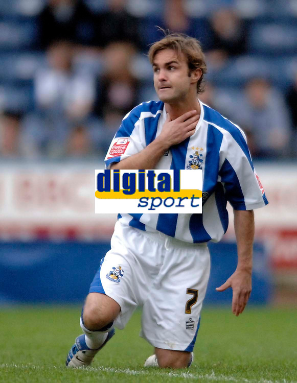Photo: Glyn Thomas.<br />Huddersfield Town v Welling United. The FA Cup. 06/11/2005.<br />Huddersfield's Chris Brandon holds his neck in pain after appearing to be elbowed by Leon Solomon.