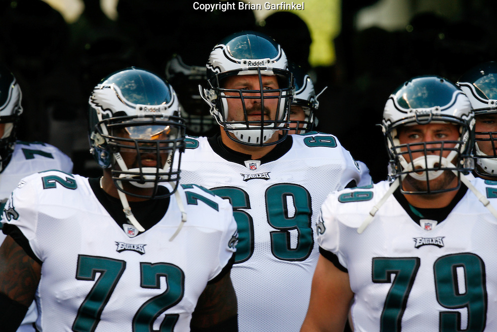 Pittsburgh, PA - PITTSBURGH - AUGUST 8: Philadelphia Eagles offensive tackle Tra Thomas #72, offensive tackle Jon Runyan #69, and offensive tackle Todd Herremans #79 enter the field before the game against the Pittsburgh Steelers on August 8, 2008 at Heinz Field in Pittsburgh, Pennsylvania. The Steelers won 16-10. (Photo by Brian Garfinkel)