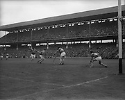 01/09/1968<br /> 09/01/1968<br /> 1 September 1968<br /> All-Ireland Senior Hurling Final: Tipperary v Wexford at Croke Park, Dublin. <br /> Tipperary' goalie, J. O'Donoghue, was all set to stop a Wexford attack, but J. Costigan was there first to stop the ball.