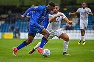 Gillingham FC forward Brandon Hanlan (7) and Peterborough United defender Colin Daniel  (3) during the EFL Sky Bet League 1 match between Gillingham and Peterborough United at the MEMS Priestfield Stadium, Gillingham, England on 22 September 2018. Picture by Martin Cole
