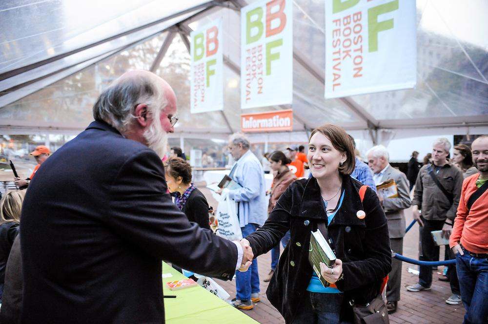 Author Nicholson Baker greets fans at the Boston Book Festival in Boston's Copley Square.