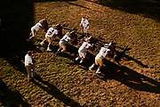 ORADELL, NJ - October 20: Offensive line coaches work their lineman during practice this week as they prepare for an intense match up with DePaul Catholic this coming week.<br /> <br /> We are in the midst of witnessing something this world has never experienced - a global pandemic. The coronavirus has swept away the world in March of 2020 - since then, the world we know It hasn't been the same. Jobs, businesses and futures have been put on hold and lost, yet, we have to power through to overcome one of the greatest obstacles this we have faced. The high school football season wasn't suppose to happen, but a glimmer of hope, intense safety measures & a little bit of luck has allowed for the season to start, now the question is ' Can It be completed?'<br /> <br /> Photo by Johnnie Izquierdo