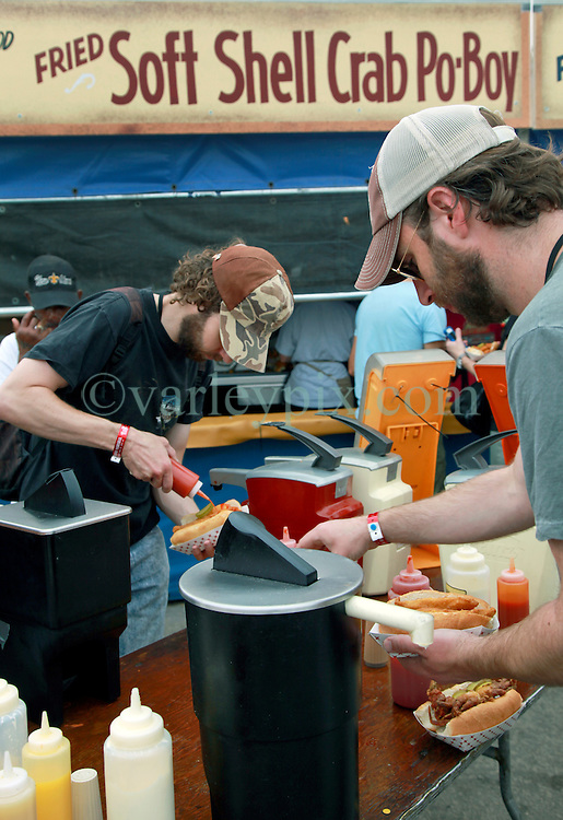 02 May 2014. New Orleans, Louisiana.<br /> Soft shell crab po-boy is a festival favorite  at the New Orleans Jazz and Heritage Festival. <br /> Photo; Charlie Varley/varleypix.com