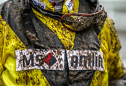 Detail of the jersey of jockey Richard Johnson covered in mud