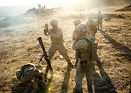 An 82mm mortar team from the 2nd Battalion, 5th Marine Regiment fires for effect from a nearby hilltop during live-fire exercises at Camp Pendleton.