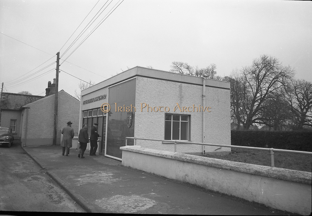 Hibernian Bank sub-office at Dunshaughlin..1965..13.03.1965..03.13.1965..13th March 1965..The Hibernian Bank sub-office at Dunshaughlin, Co. Meath was broken into lat night, it has not yet been determined how much money the raiders managed to escape with...Image shows a Garda Sergeant and Detectives entering the bank premises to inspect the scene.