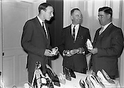 01/04/1963<br /> 04/01/1963<br /> 01 April 1963<br /> Edenderry Shoe Co. reception at Russell Hotel, Dublin. Picture shows (l-r): Mr. Peter Watchman, Director; Mr. B. Noble, (Dublin and Northern Rep.) and Mr. T.Walsh, (Southern Rep.).
