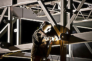 © 2007 Randy Vanderveen, all rights reserved.A welder works on part of the steel skeleton of a new shopping centre under construction  in south Grande Prairie before sunrise.