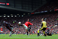 Ruud Van Nistelrooy touches the ball over Dean Keiley to score the 2nd of his 3 goals for Manchester United, United's 3rd. Manchester United v Charlton Athletic, FA Premiership, 3/05/2003. Credit: Colorsport / Matthew Impey DIGITAL FILE ONLY