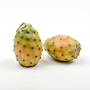 Fresh and organic fruit of the Indian fig opuntia (AKA Barbary fig, cactus pear, spineless cactus, and prickly pear) on white background