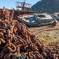 Abandoned boats and piles of rusting chains litter Grytviken, a recently-shuttered whaling station on  Cumberland Bay, South Georgia, Antarctica.