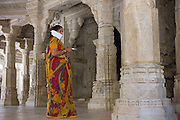 Jain pilgrim with traditional mask at The Ranakpur Jain Temple at Desuri Tehsil in Pali District, Rajasthan, India