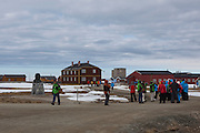 Chinese tourist walks past the statue of Amundsen at  the international scientific research base at Ny Alesund, Svalbard, while travelling on board the Hurtigruten cruise ship Fram.