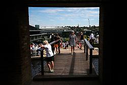 8 July 2017 - Wimbledon Tennis (Day 6) - Wimbledon can be seen through a brick arch - Photo: Charlotte Wilson
