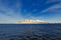 Approaching Alesund. Image taken with a Nikon D2xs and 12-24 mm f/4 lens (ISO 200, 12 mm, f/9.5, 1/350 sec).